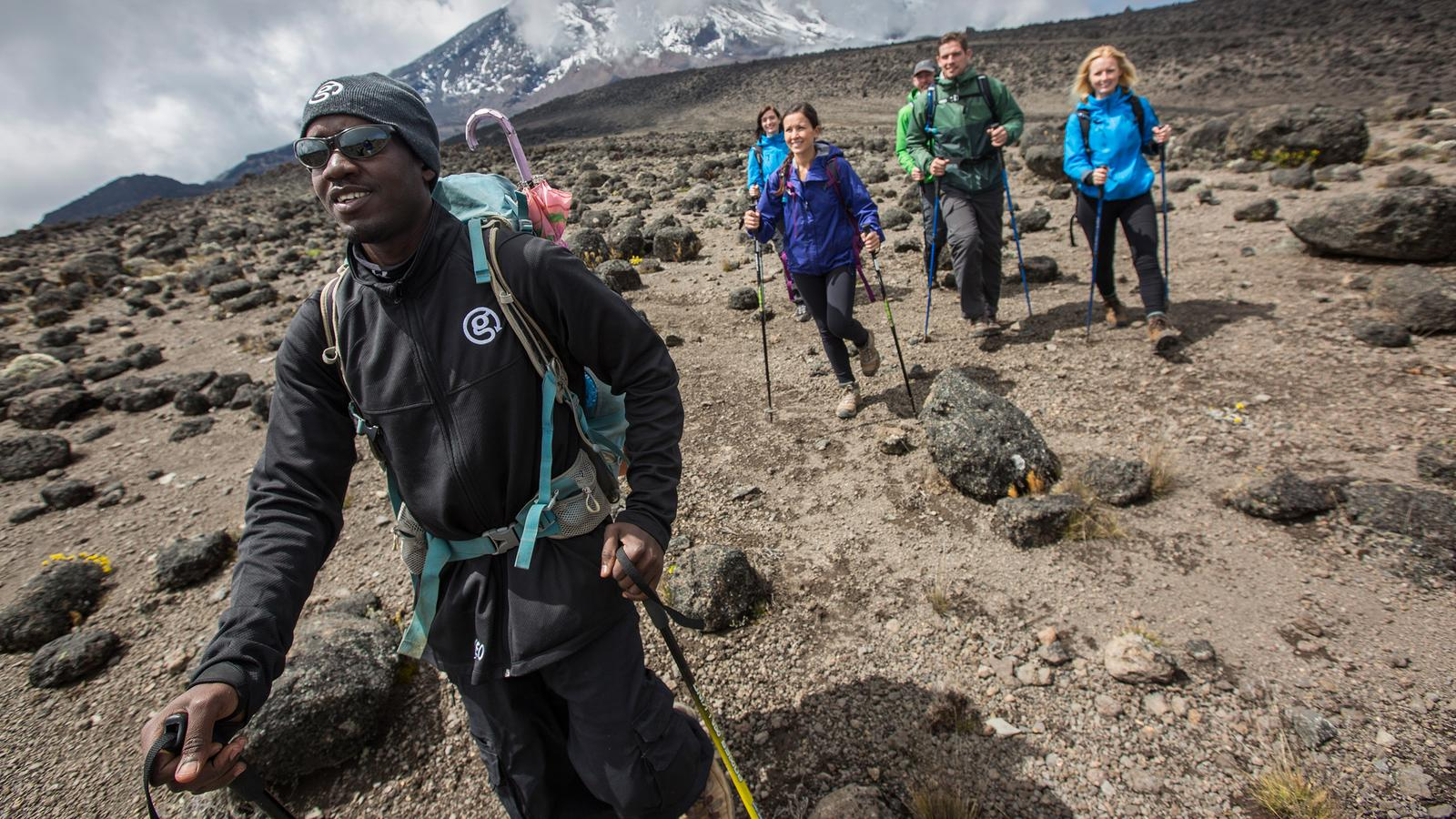 CEO and group hiking up the challenging but incredible Mt.Kilimanjaro in Tanzania