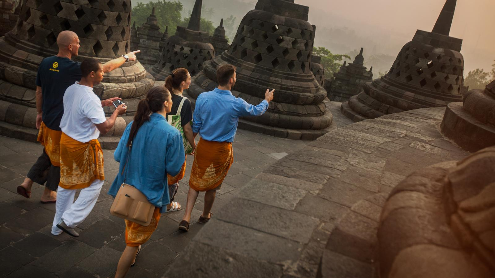 Leading the travellers through Borobodur Temple in Java