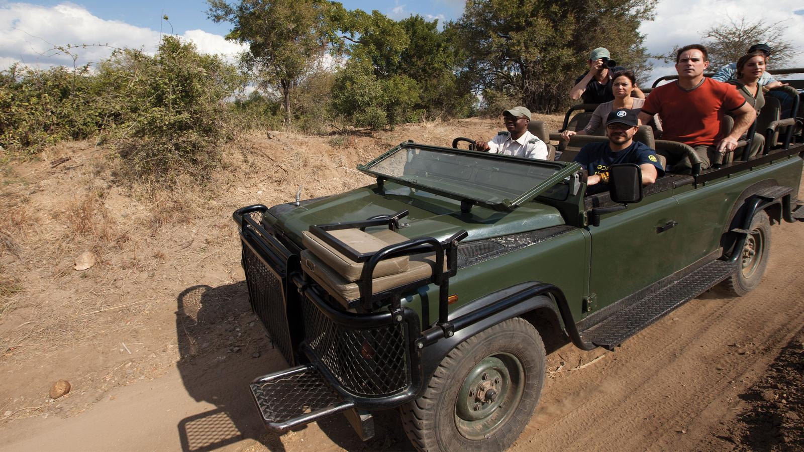 Travellers driving through the Timbavati Game Drive in South Africa