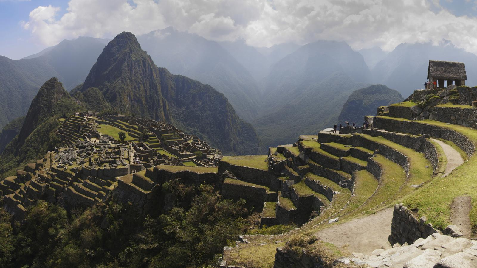 A wide photograph of the spectacular Machu Picchu