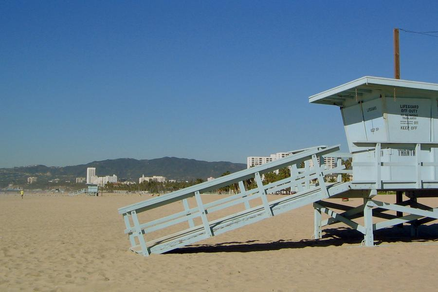 Grab a spot of sand and watch the sun set on Venice Beach.