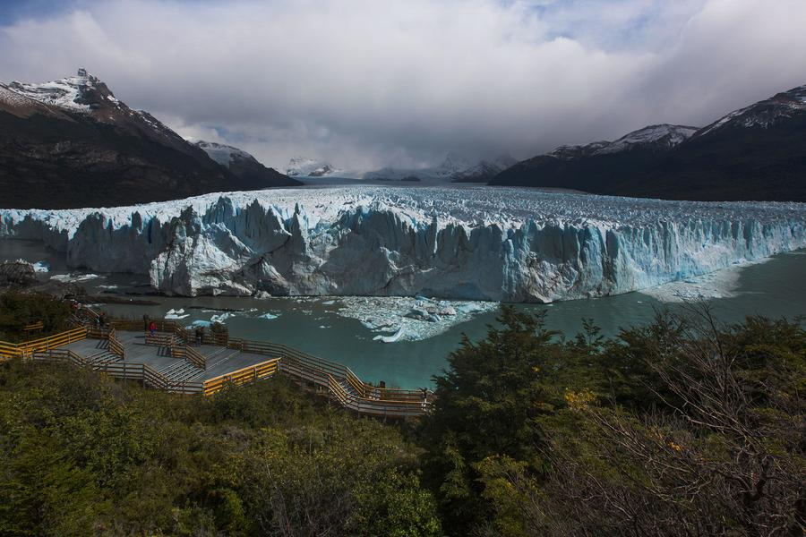 Join Travel blogger Michael Turtle in the shadow of Argentina's Perito Moreno as huge icebergs on the glacier's face cave and collapse.