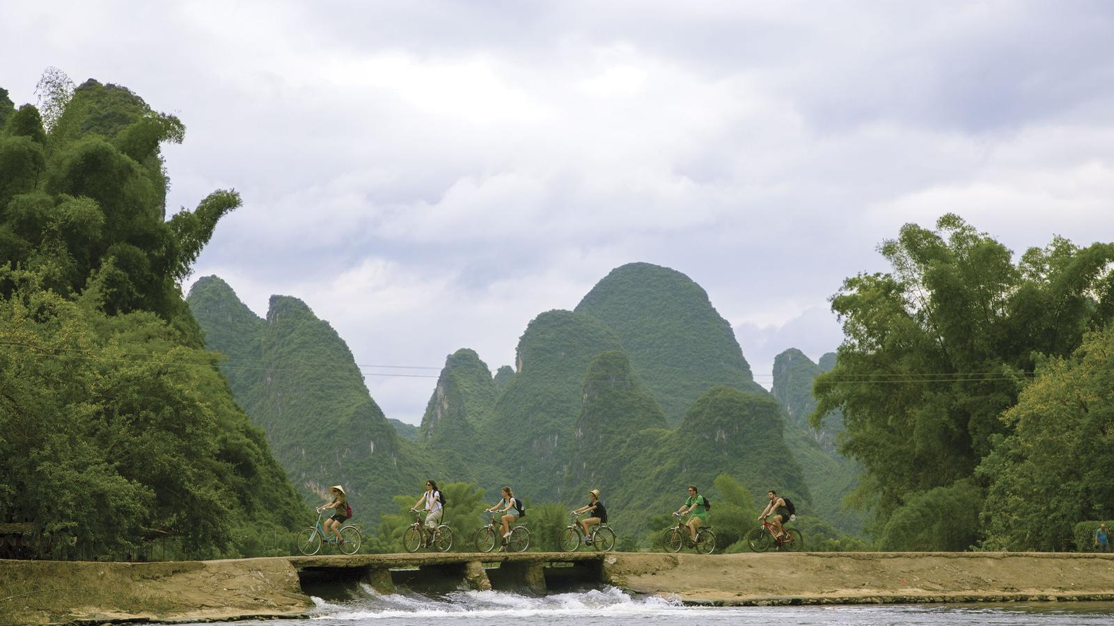 The group cycling through the countryside in China