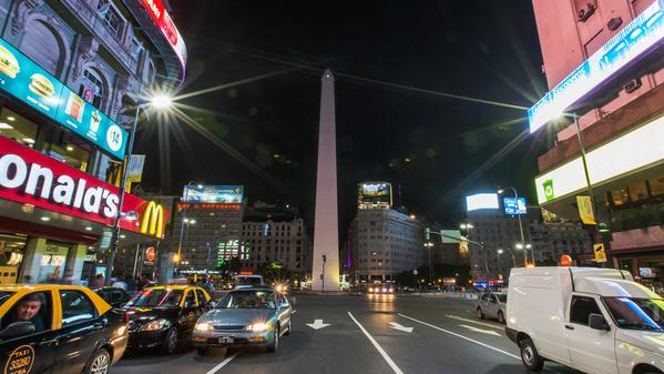 The lights of city life swirl around this iconic Argentinian monument.