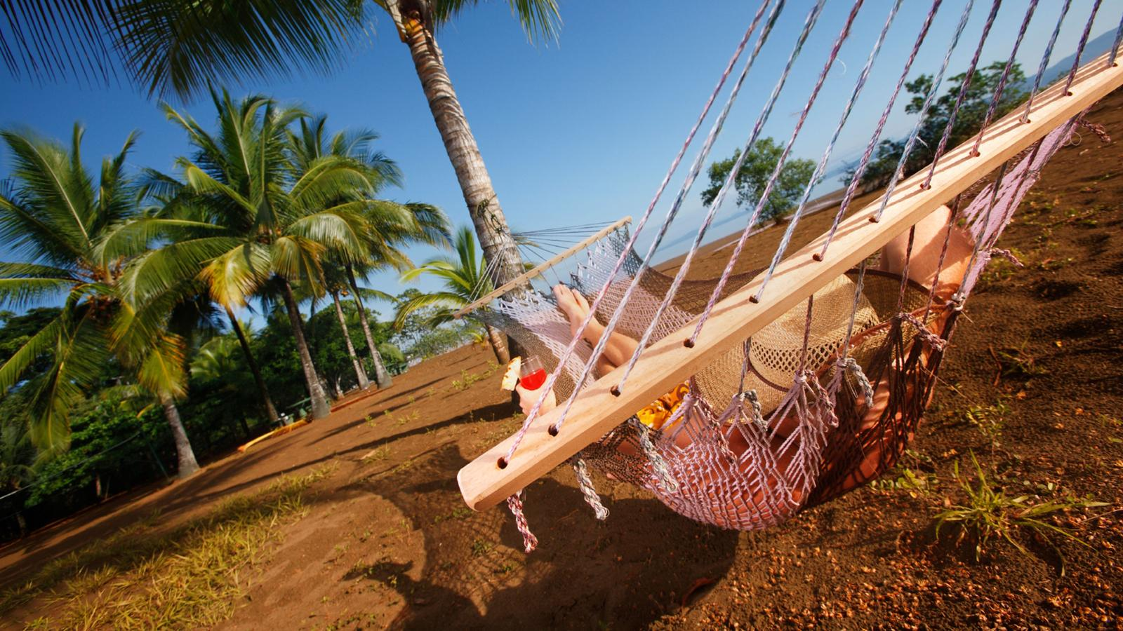 Female traveller hanging out on a hammock