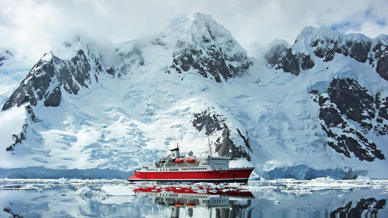 The G Expedition In Aitcho Island, Antarctica With Zodiac At Sea