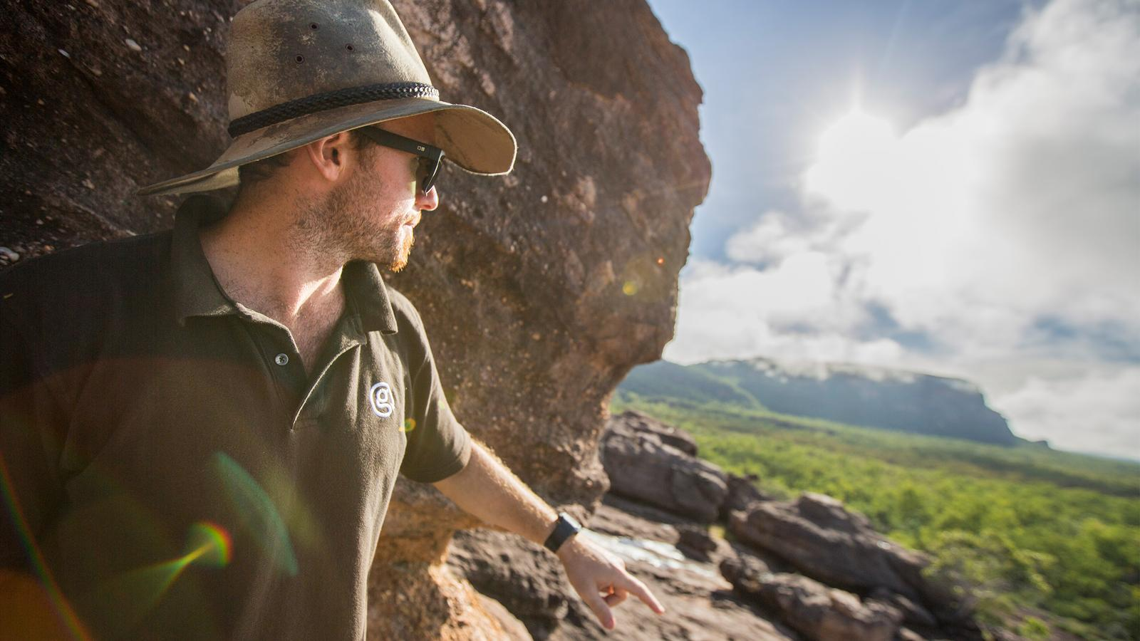Guide looks toward beautiful green scenery in Kakadu National Park, Australia