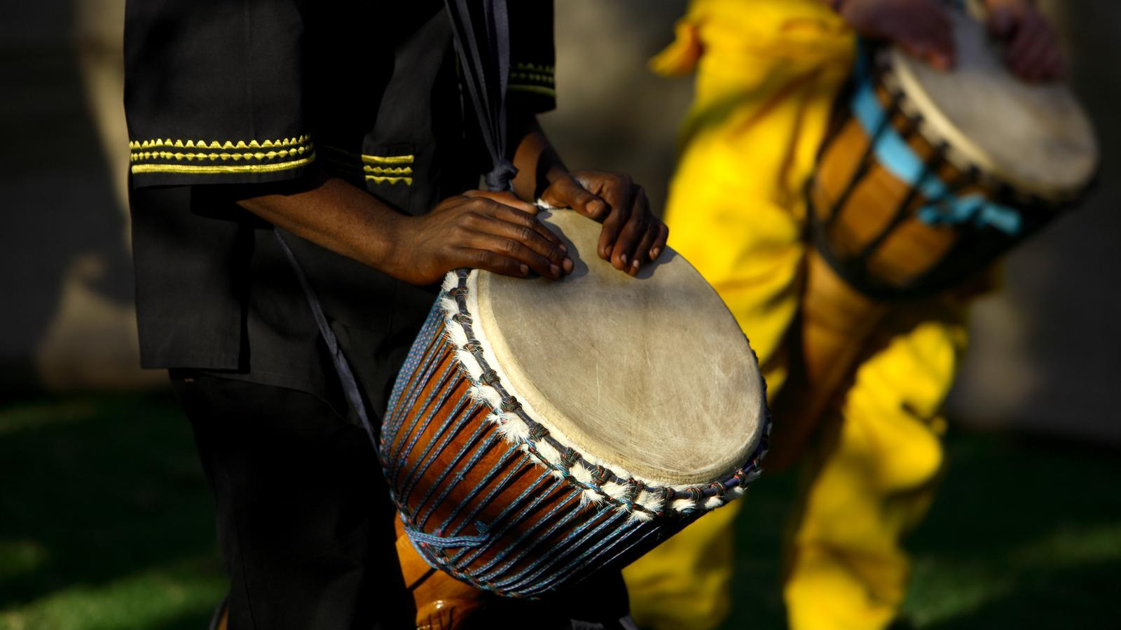 Close up of hands on drums during reggae performance