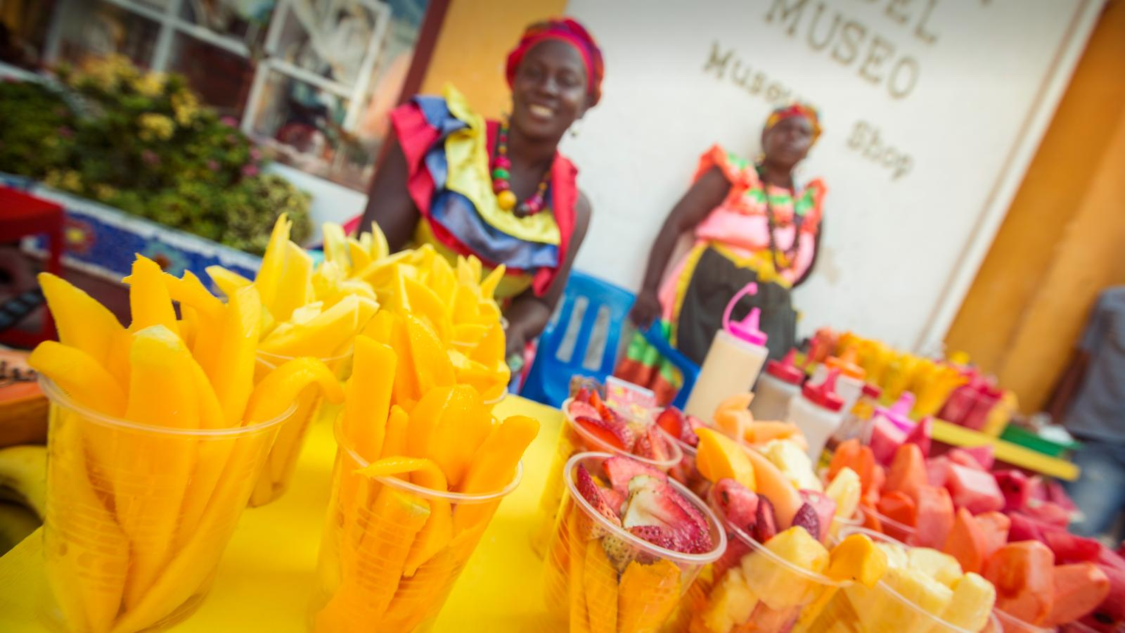 Local women selling fruit at the market in Cartagena, Colombia