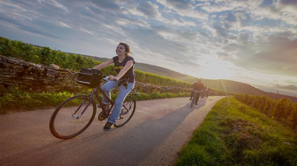 Our video takes us to a bike path in Beaune, France, where these travellers are pedalling into magic hour.