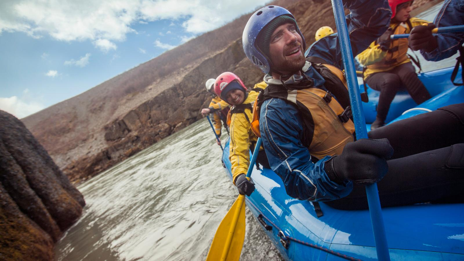 Travellers kayaking down the white waters of the Golden Circle in Iceland