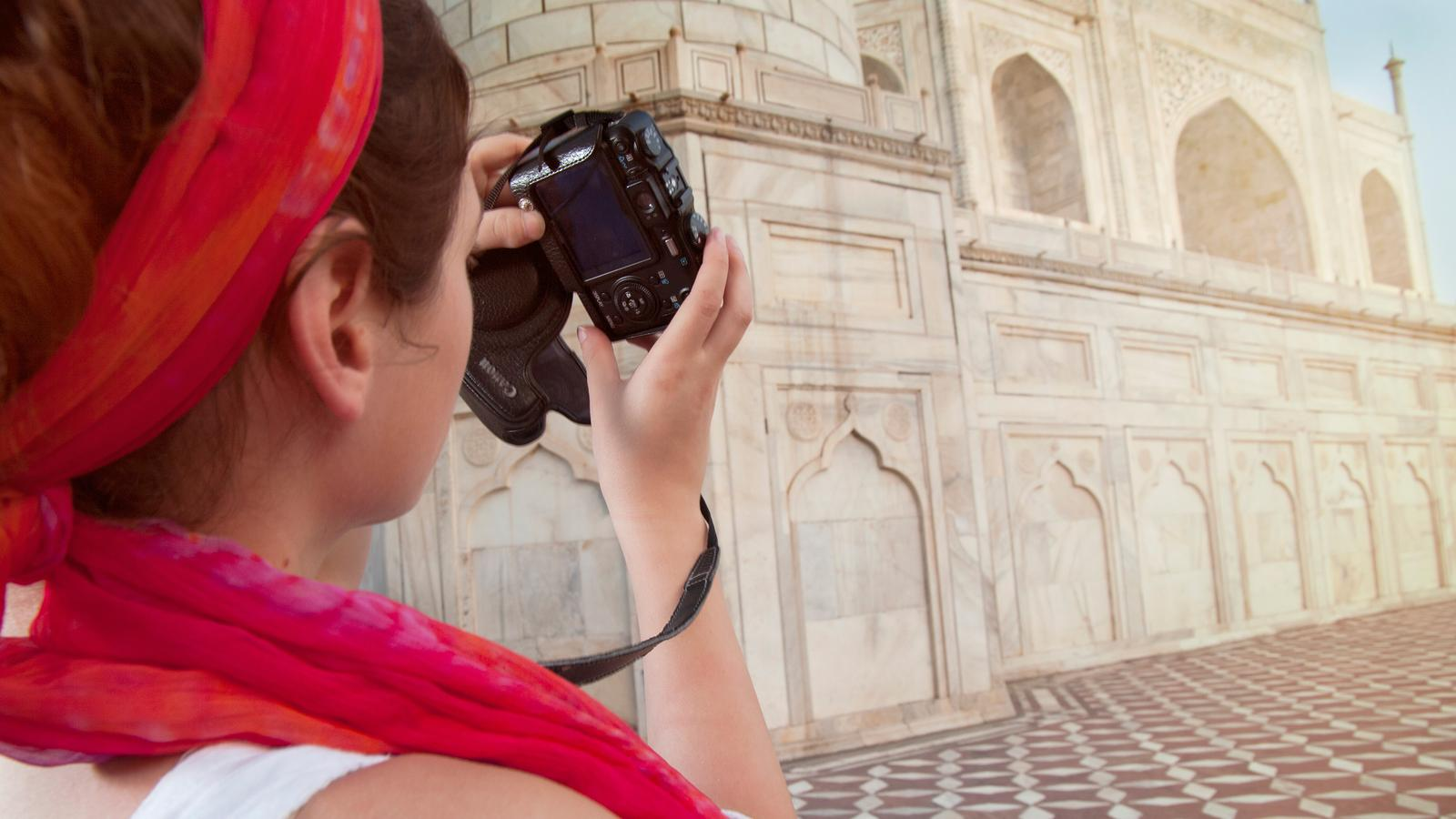 A traveller taking photos of the incredible Taj Mahal in Agra, India
