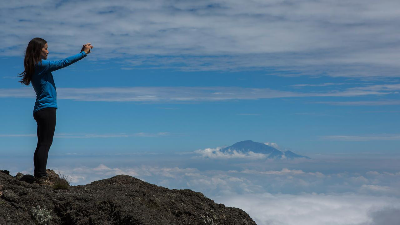 """Join G Adventures traveller and soon-to-be newlywed Sarah Manion as she ascends to the fabled """"roof of Africa."""""""