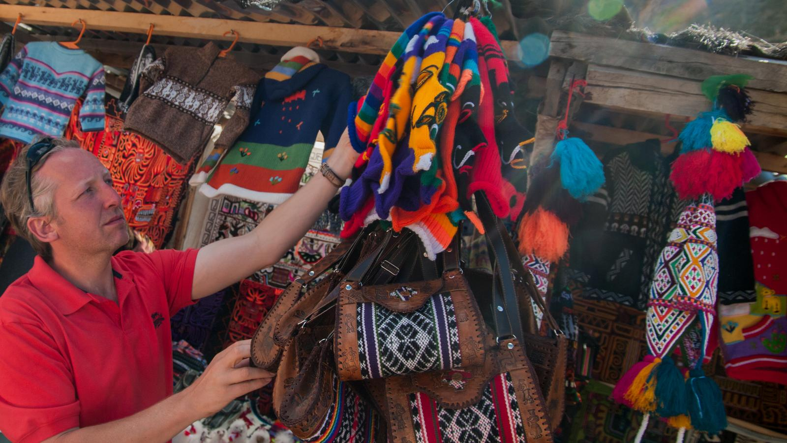 Traveller checking out the market at Machu Picchu
