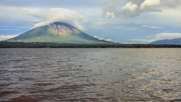 Clouds cover summit of volcano at Lake Ometepe, Nicaragua