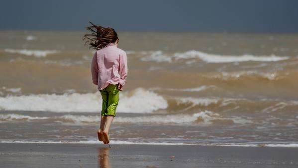 Travel photographer Peter West Carey watches his daughter run free on Essaouira's coast in Morocco.