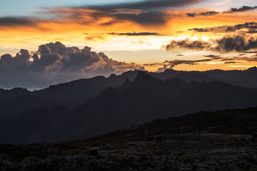 See the skies come alive with colour as the sun sets on another day over Kilimanjaro's shortest peak.