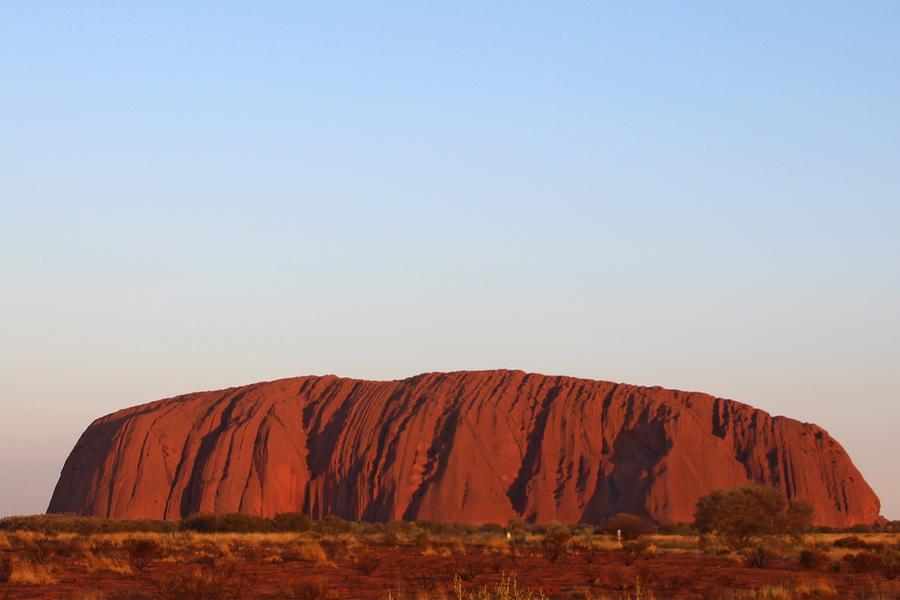 Watch the sun break over Australia's Uluru—the birthplace of creation according to Aboriginal legend.
