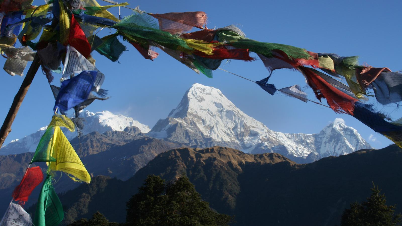 Prayer flags frame Annapurna Mountain