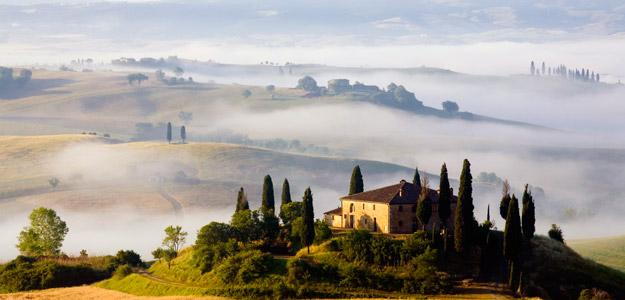 Early-morning mist over the hills of Tuscany