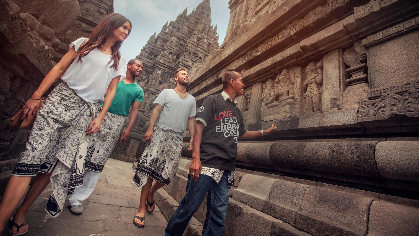 CEO leading travellers on a guided tour of Prambanan Temple