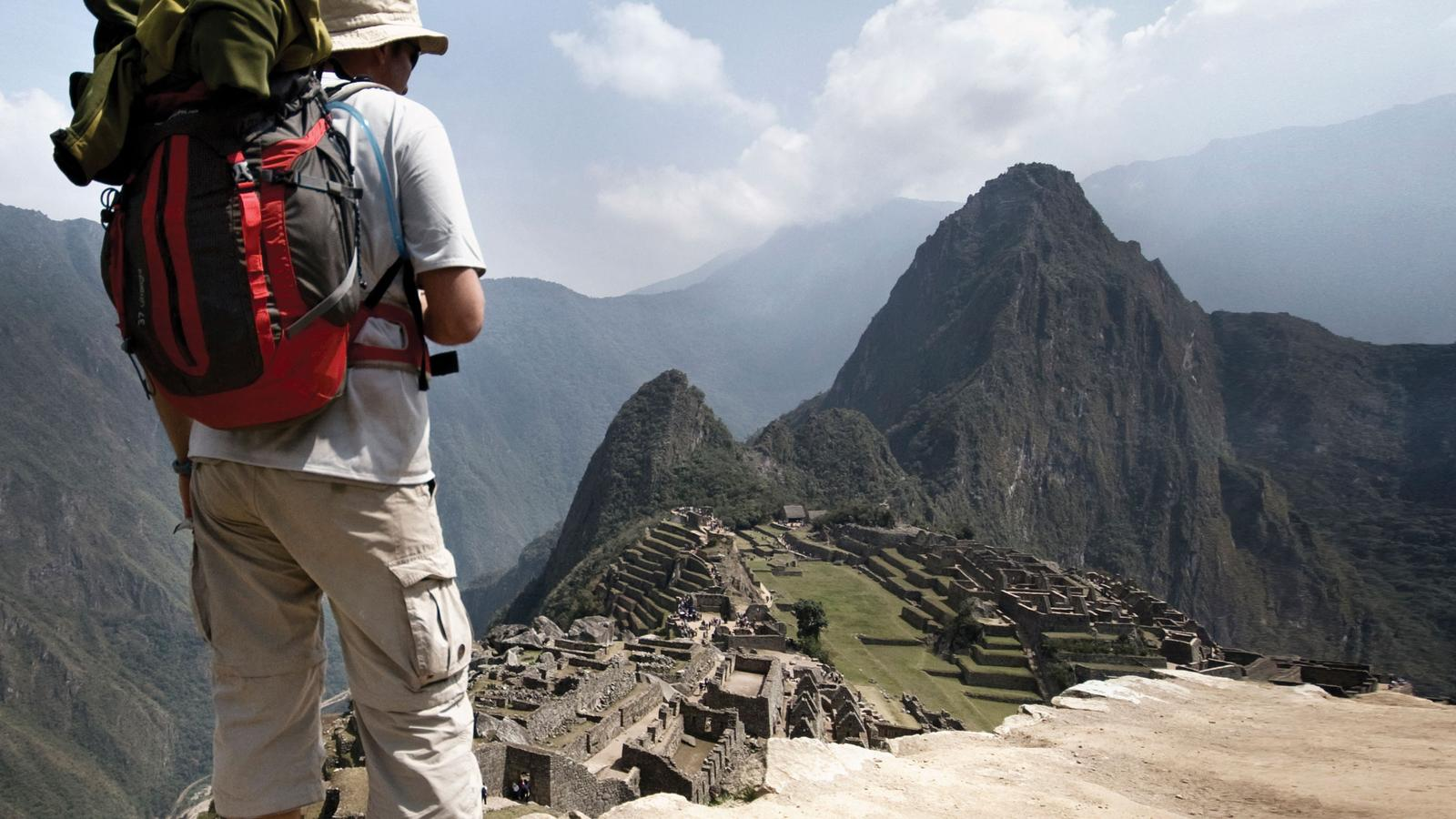 Hiker takes in the view of Machu Picchu