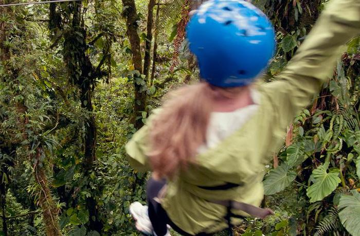 Female tourist ziplining in Costa Rica's Monteverde cloud forest reserve.