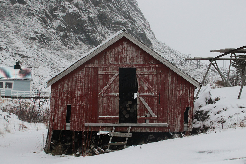 Things that jog my memory: stacks of firewood keeping dry in Lofoten woodsheds.