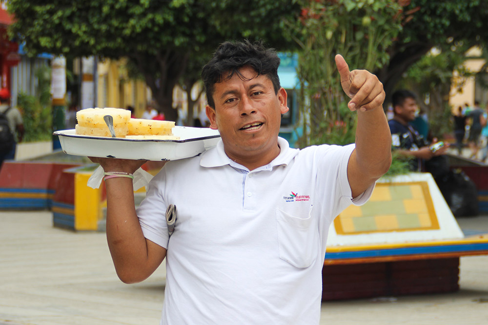 One last wave to Juan, a fruit vendor in Tumbes.