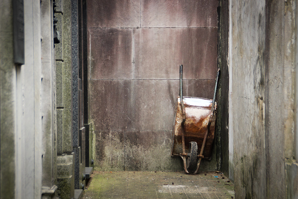 A wheelbarrow at the end of an alleyway caught my attention.