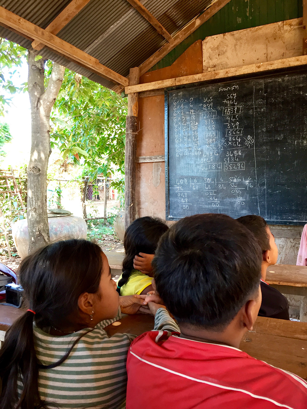 Pupils contemplate a thorny sum at a local school on Koh Chen Island.