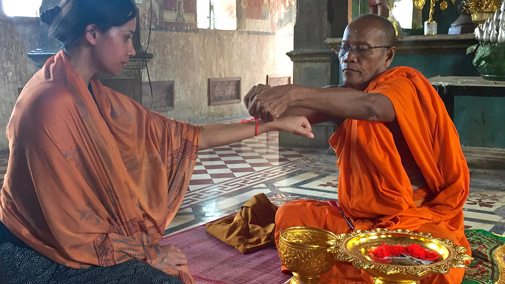 A Buddhist monk offers blessings at Wat Kampong Tralach Leu pagoda.
