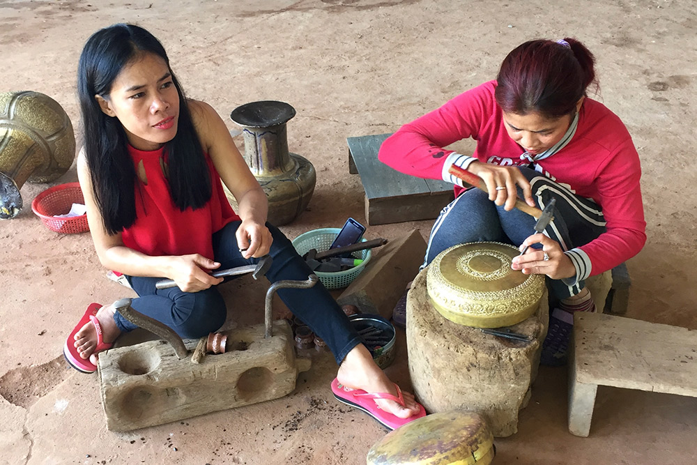 Local craftswomen at a copper factory in Koh Chen.
