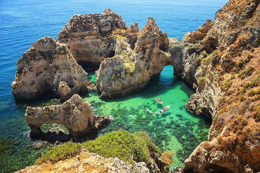 Natural arches and sandstone cliffs at Ponta da Piedade. Photo courtesy Madrugadaverde, Dreamstime.
