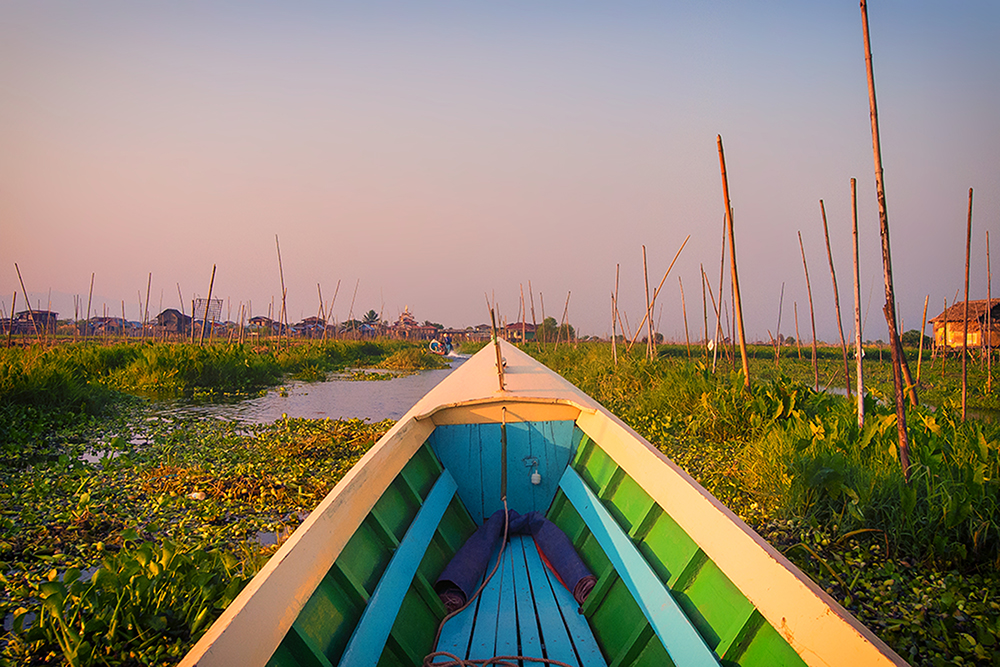 Meandering through water lilies and hyacinths on Inle Lake.