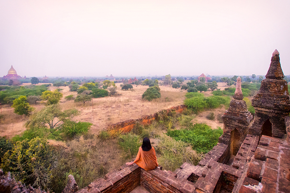 Kia looks out onto a misty vista over Bagan.