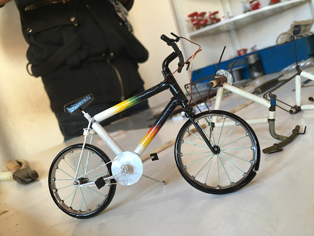 These tiny model bicycles are fashioned from recycled materials.