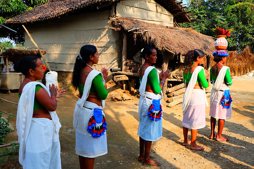 The Tharu women give us a warm welcome as we arrive.