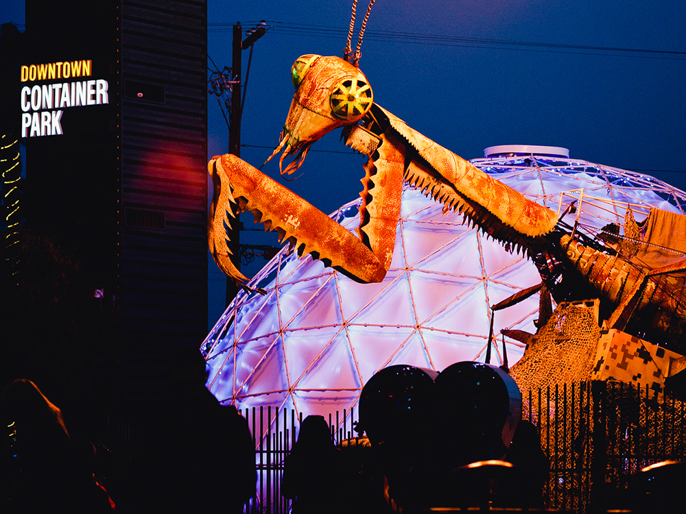 A giant, fire-breathing praying mantis sculpture overlooks Downtown Container Park in Las Vegas.