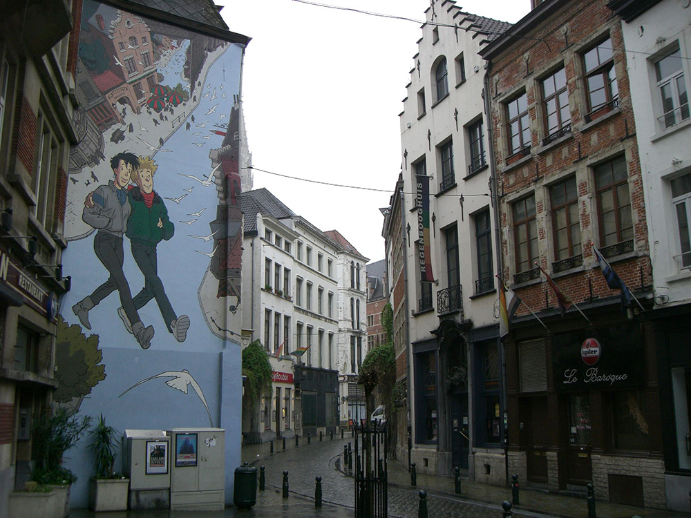 The comic character Broussaille, with red hair, walks on air with his friend Catherine on the side of a building in Brussels. Photo courtesy of Adam L.