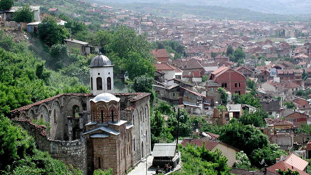 You'll find Prizren sunken in a tight river valley below mountains often lost in fog. Photo courtesy Wiki.