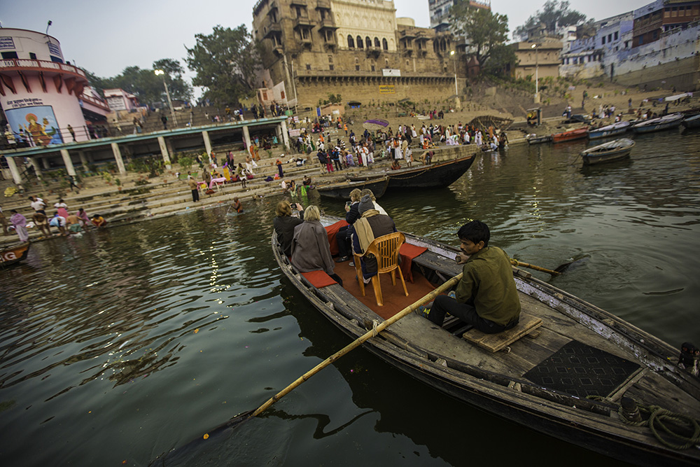 A boat glides down the sacred Ganges.