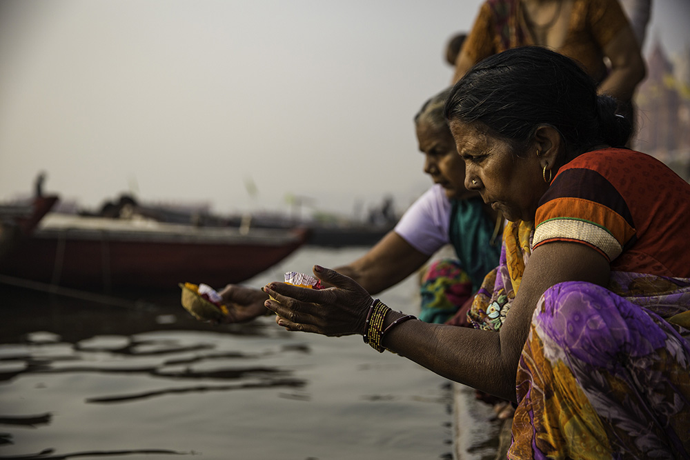 Women gather along the banks of the Ganges.