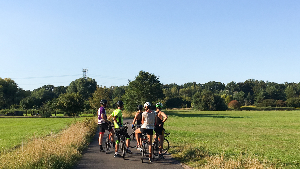 Our bicycling group collects in a field on the northern edge of where the Berlin Wall stood to ponder what it must have looked like 30 years before.