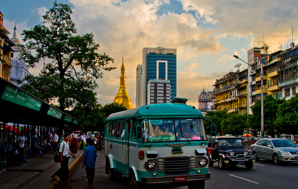 Burma's buses are cheap and convenient — just don't ask if they're running on time. Photo courtesy of Onny C.