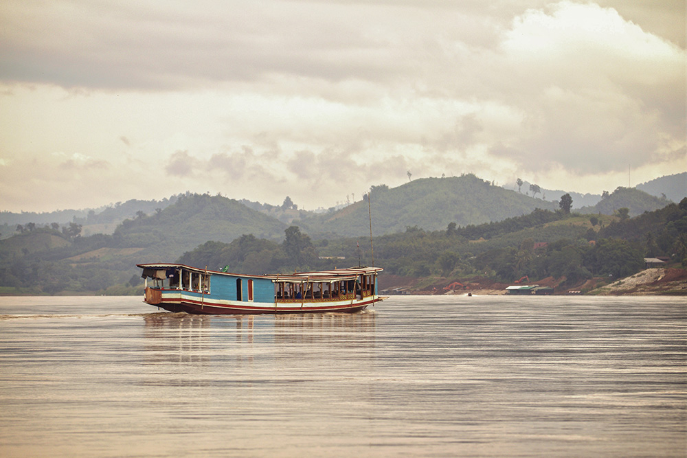 The Mekong river flows through Laos.
