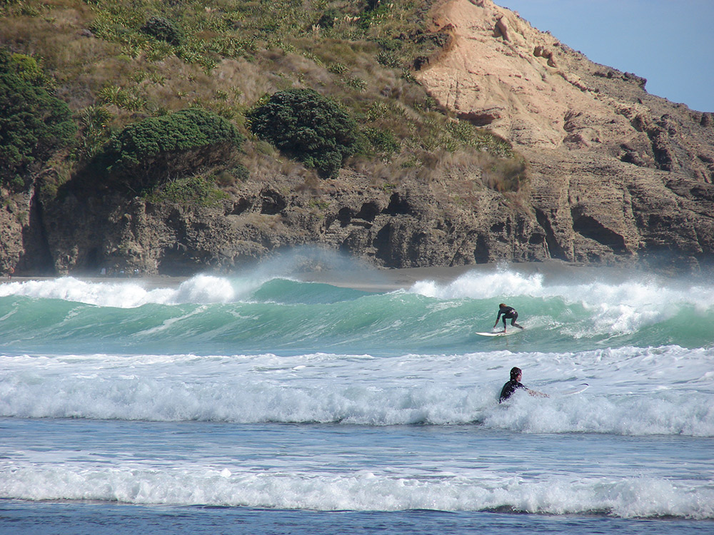 Take a surfing lesson on the iconic Piha beach. Photo courtesy John C.