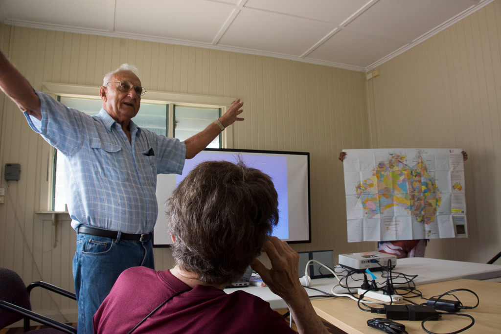 Dr. Grant answers a question from our group. The Aboriginal map of Australia is held up for reference.