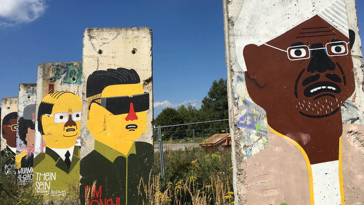 Far outside the city centre we found Berlin Wall segments — one section with the world's dictators and the other with leaders of peace. A rather fitting message.