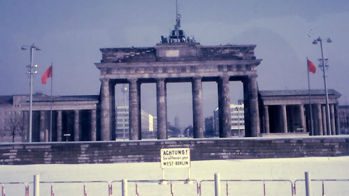 The Berlin Wall goes around Brandenburg Gate, looking in from West Berlin. Taken by the author's father during a visit to Berlin in 1969.